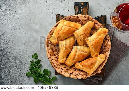 Fried Empanadas With Cilantro, Meat, Egg, Tomato And Chili Sauce On Grey Background. Chilean Typical