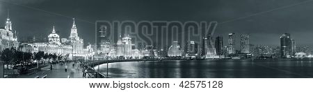 Shanghai Waitan night view with historic buildings over Huangpu River panorama in black and white