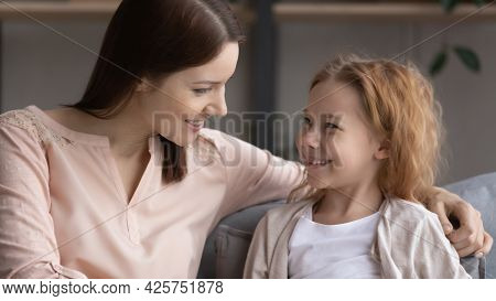 Happy Preteen Girl Sit On Couch Talk To Female Teacher