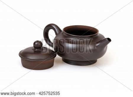 Porcelain Brown Teapot In Chinese Style Isolated On A White Background