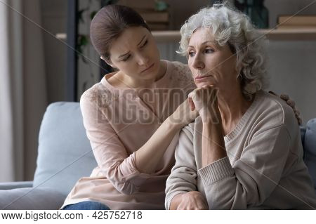 Young Female Caregiver Support Grieving Suffering Mature Old Woman Retiree
