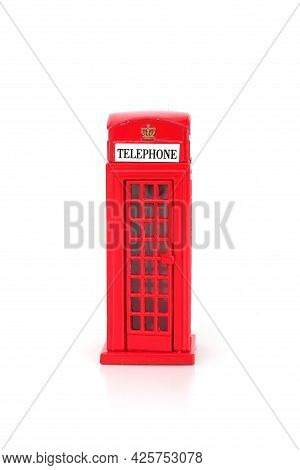 The Famous English Red Telephone Box. Miniature Layout Isolated On A White Background