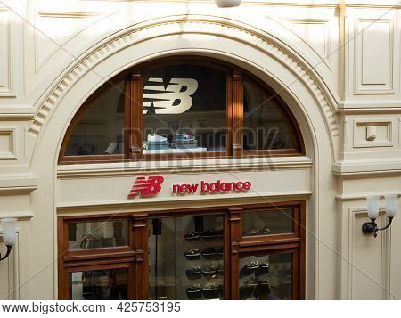 10.04.2021 Russia, Moscow. The Sign Of The New Balance Company In The Russian Gum Store.