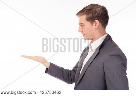 Handsome Caucasian Businessman Look At Copy Space, Palm. Young Businessman Open Palm. Attractive Guy