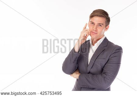 Young Handsome Business Man In Suit Looking At Camera Thinking Or Dreaming Thoughtful Businessman Ha
