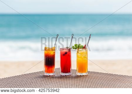Bright Healthy Berries Cocktails On Table On Beach With Blue Sea On Background. Concept Of Summer Va