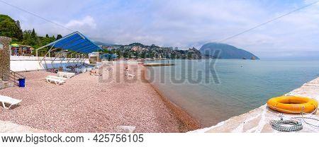 Tourists On Vacation On The Black Sea Coast In Gurzuf (panoramic Seascape). Gurzuf Resort-town, Yalt