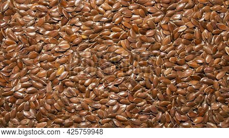 Flax Grains Background.the Texture Of Flax Grains Is A Top View.