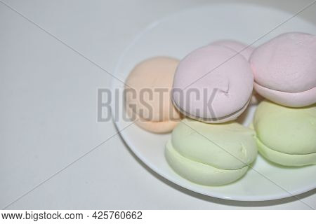 Colorful Delicious Marshmallows On A White Plate