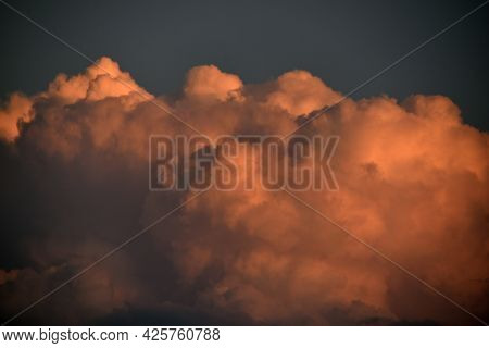 Evening Cumulus Red And Blue Clouds Over The City