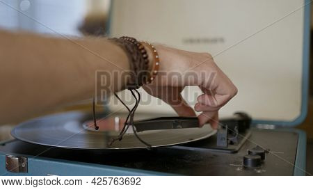 Close-up Of Hand Putting Record In Vinyl Player. Action. Man Puts Vintage Record In Modern Stylish R