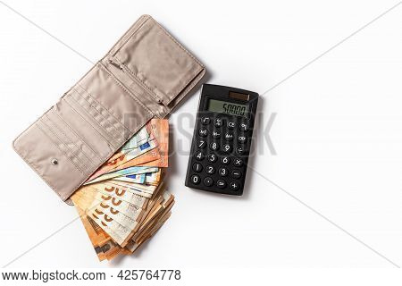 Money. Cash. Euro Bills In The Wallet And Calculator. The Salary. Poverty And Wealth Concept. Money