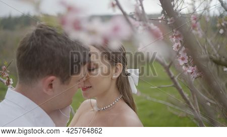 Newlyweds Gently And Passionately Touch Each Other. Action. Beautiful Couple Passionately Touch Each