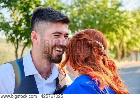 Turkish Man And His Beloved Caucasian Plus Size Red Headed Woman Embracing. Mixed Race Couple Cuddli