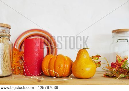 Autumn Still-life On A Kitchen Table At Home. Pumpkins, Falling Leaves