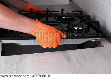 Installing  Gas Hob In  Kitchen Set, Hands Of  Master Close-up