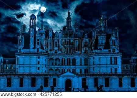 Haunted Gothic Castle At Night. Old Spooky Mansion Like Palace In Full Moon. Creepy Front View Of Da