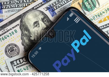 Moscow - June 10, 2021: Paypal Logo On Smartphone Screen And Dollar Bills, Digital App For Payment I
