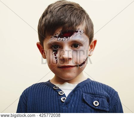 Little Cute Child With Facepaint On Birthday Party, Zombie Apocalypse Facepainting, Halloween Prepar