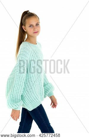 Pretty Stylish Teenage Girl In Fashionable Outfit. Teenage Girl With Ponytail Wearing Warm Oversized