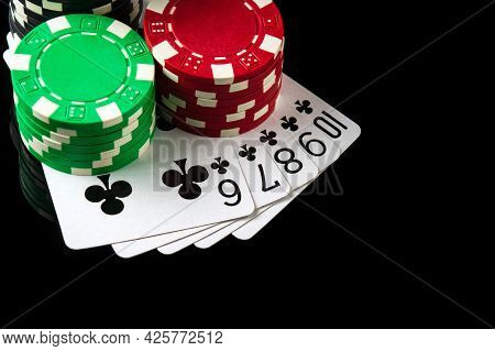 Poker Game With Straight Flush Combination. Chips And Cards On The Black Table In Poker Club