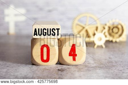 Cube Shape Calendar For August 04 On Wooden Surface With Empty Space For Text.
