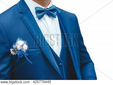 A Man In A White Shirt, Blue Suit With A Butterfly And A Boutonniere On White Background, Isolated,