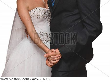 The Bride And Groom Hold Hands During A Dance At The Wedding On A White Background, Isolated.