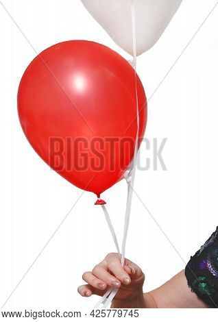 The Woman's Hand Holds 2 Balloons On A Rope Red And Light Color On A White Background, Isolated.