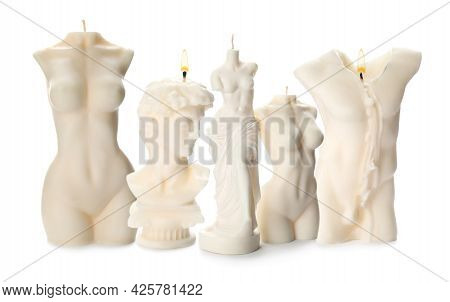 Collection Of Beautiful Sculptural Candles On White Background