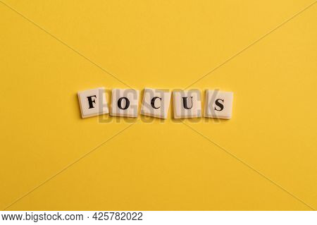 Square Letters With Text Focus Isolated On Yellow Background