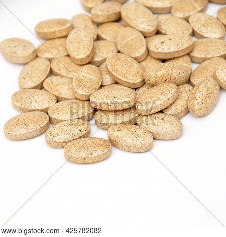 Beige Oval Tablet Pills Isolated On White Background, Medical Oval Pills Tablets