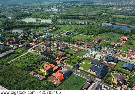 Turtle Roofs Of Luxury Houses And Cottages In A Natural Landscape Park Near The City - Aerial Drone