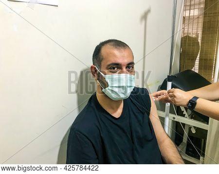 Beyoglu, Istanbul, Turkey - 06.23.2021: Medium Shot Of Young Man With Protective Mask Look At Camera