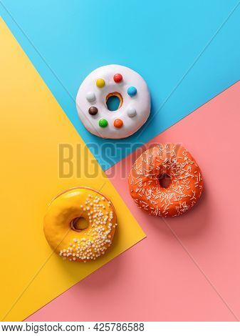 Creative Layout Made From Delicious Glazed Donuts. Vertical Flat Lay - Donuts Or Doughnuts On Colorf