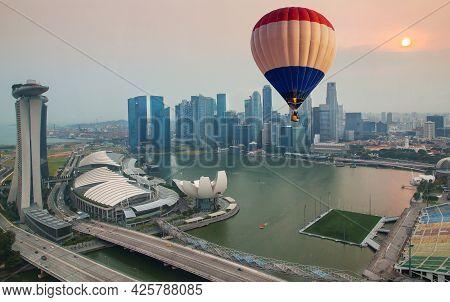 Marina Bay, Singapore - October 4, 2014: Aerial View Of Hot Air Balloon Flying Over Marina Bay. Scen