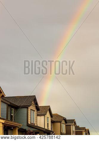 Rainbow Over The Row Of New Houses After A Thunderstorm In Denver, Colorado