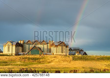 The Stormy Sky And Rainbow Above The New Gaylord Rockies Resort And Convention Center In Denver, Col