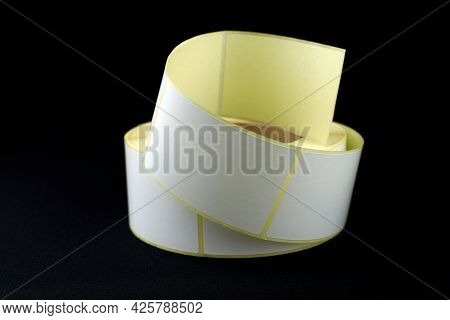White Roll Of Labels For Thermal Perforation. Stickers For Thermal Or Thermal Transfer Printing. Bab