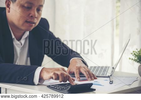 Asian Business Man Hands Using Calculator Counting Tax Financial Bill. Tax Audit Finacial Concept. C