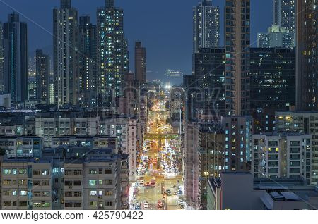 Night Scenery Of Busy Street In Downtown District Of Hong Kong City