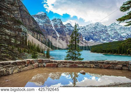 Magnificent mountain lake Moraine. Travel to northern Canada. Canadian Rockies. The glacial lake is fed by glacier melt water and is located in the Valley of the Ten Peaks.