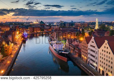 Amazing architecture of the main city in Gdansk at sunset, Poland. Aerial view of Granaries Island at the Motlawa river