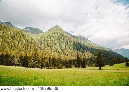 Natural Landscape With Green Mountain Peaks In Summer