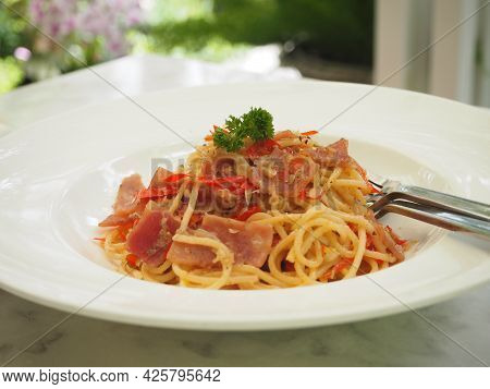 Spaghetti With Spicy Chili Bacon Mixed, Food In White Plate On Marble Table