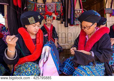 Unidentified Female Mien Hilltribe Embroider Pattern Colored Thread At Doi Mae Salong.