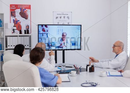 Hospital Teamwork Discussing With Neurologist Senior Doctor During Online Videocall Teleconference D