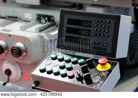 Lathe Machine With Remote Control Panel And 3 Axis Digital Readout Console. Selective Focus.