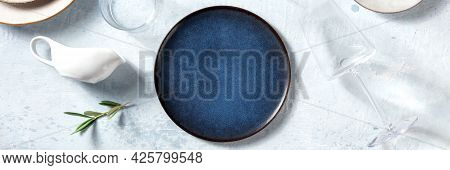 Dinnerware Panorama With A Blue Plate, Olive Branch, A Trendy Wine Glass And A Sauce Boat, Overhead