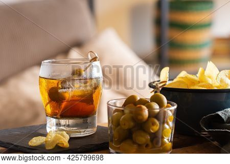 Vermouth, Olives, Fried Potatoes On A Table At Home
